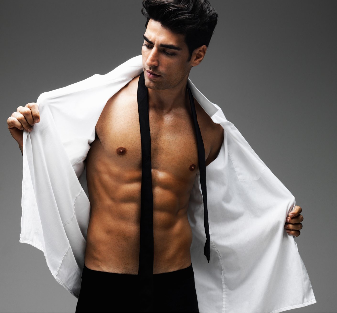 male model taking off dress shirt