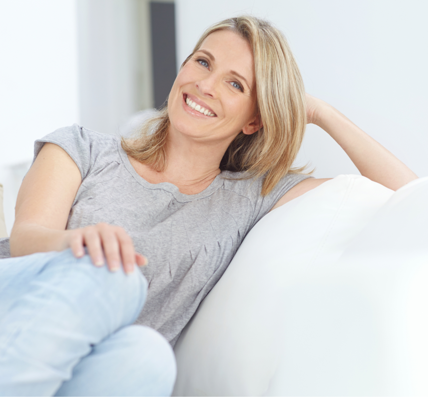 woman smiling sitting on a couch